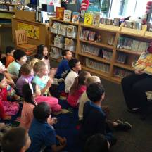 Irvine Community Services Commissioner Melissa Fox reading to first graders at Northwood Elementary School