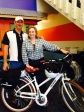 Irvine Community Services Commissioner Melissa Fox with Irvine Pedego Electric Bicycle owner Bob Bibee