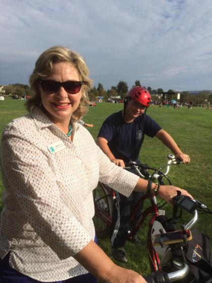 Irvine Community Services Commissioner Melissa Fox and her son, Max, bicycling in Woodbridge.