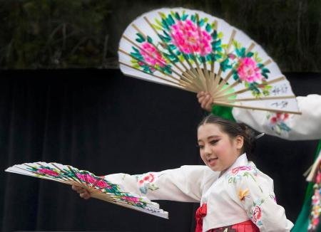 Korean American Youth Performing Artists mix colorful fans and clothing with graceful dance during the Korean Cultural Festival at Irvine City Hall on Sunday. ///ADDITIONAL INFO: - Photo by MINDY SCHAUER, THE ORANGE COUNTY REGISTER - shot: 051416 i.0514.koreanfestival Thousands attend the seventh annual Irvine Korean Cultural Festival, which commemorates Korean immigration to the United States since Jan. 13, 1903.